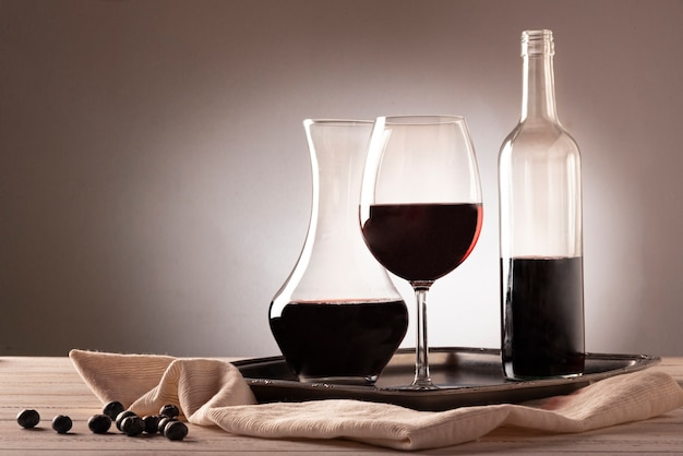 Wine bottle with glass and carafe Free Photo