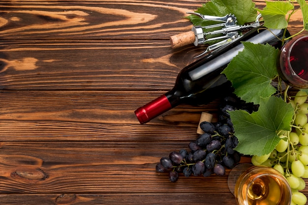 Wine bottle on wooden background Free Photo