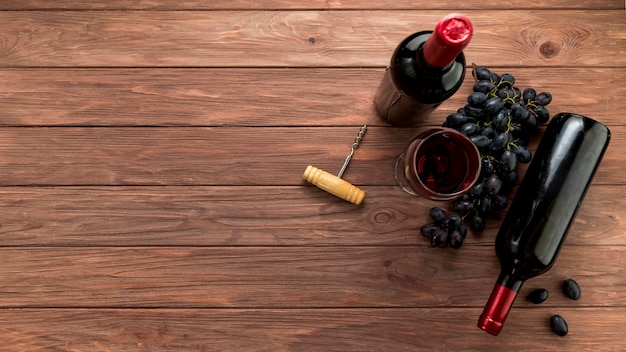 Wine bottle on wooden background Free Photo