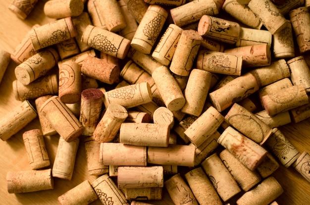 wine-corks-heap-wooden-background_93314-1041.jpg