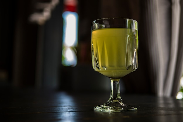 Wine glass with lemonade in a summer cafe Premium Photo