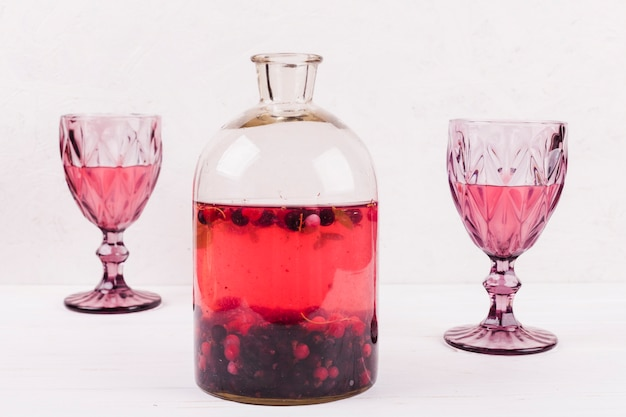 Wine glasses with drink and compote Free Photo