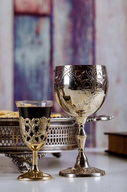 Wine for passover with metal tray and matzo on table Premium Photo