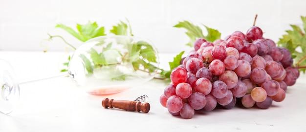 Wine pink and grape bunch. Premium Photo