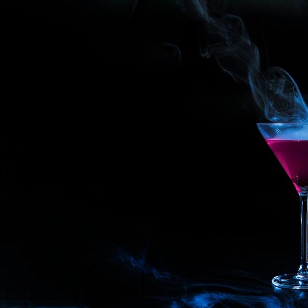 Wineglass with rose smoky liquor Free Photo