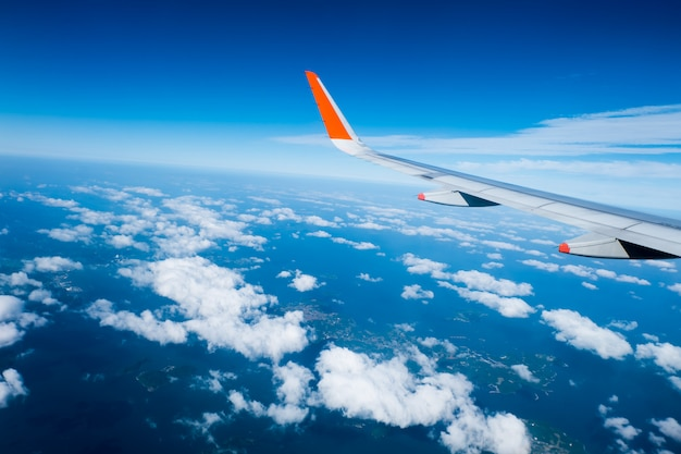 Wing of airplane from window Premium Photo