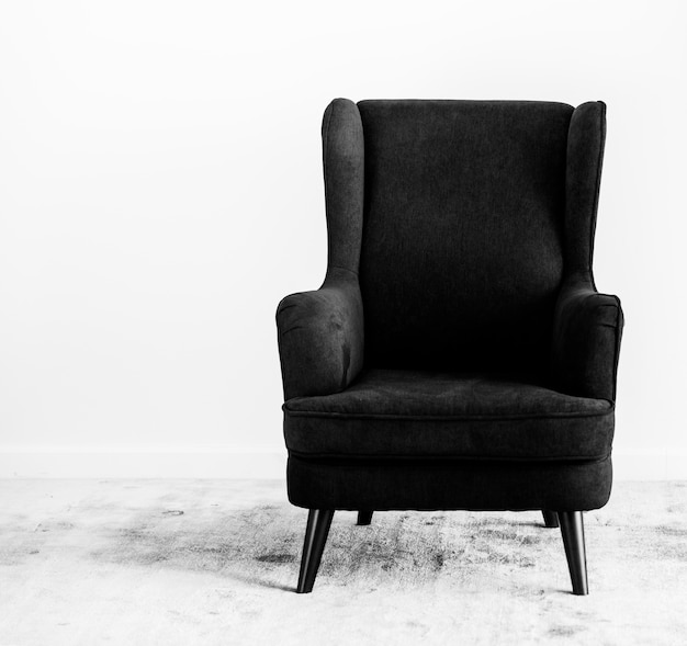 Wing back chair on a carpet no people Free Photo