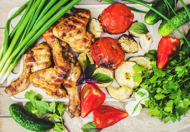 Wings and grilled vegetables. selective focus. Premium Photo
