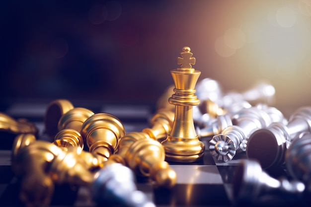 Winner of chess game board, golden victory king win in successful business competition Premium Photo