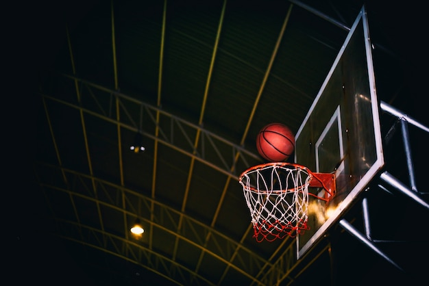 The winning points scoring at a basketball game Premium Photo