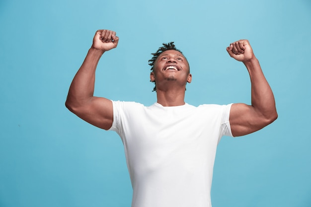 Winning success afro-american man happy ecstatic celebrating being a winner. dynamic energetic image of male model Free Photo