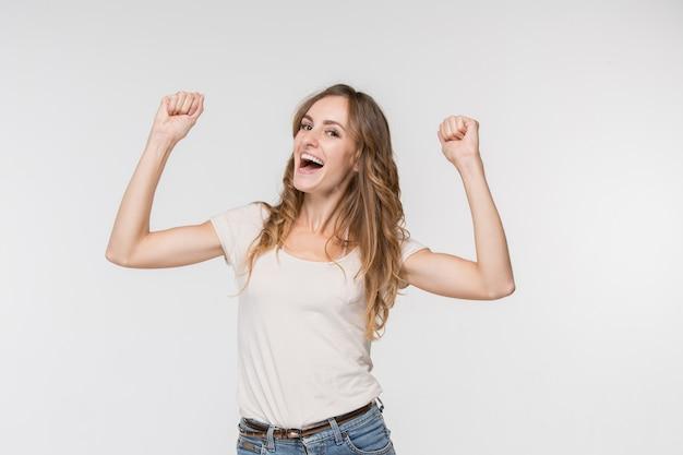 Winning success woman happy ecstatic celebrating being a winner Free Photo