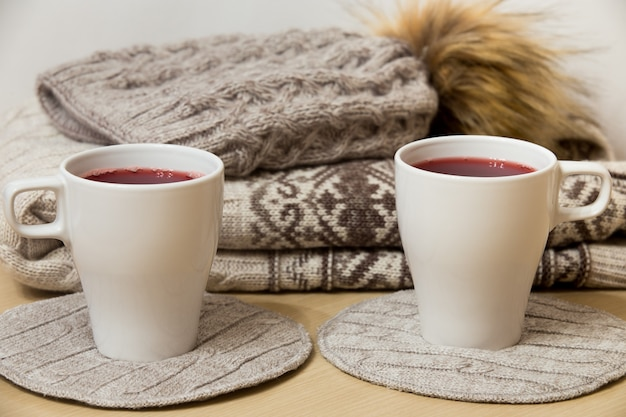 Winter clothes and two cups of mulled wine Free Photo