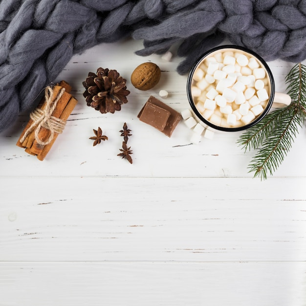 Winter composition with hot chocolate on wooden table Free Photo