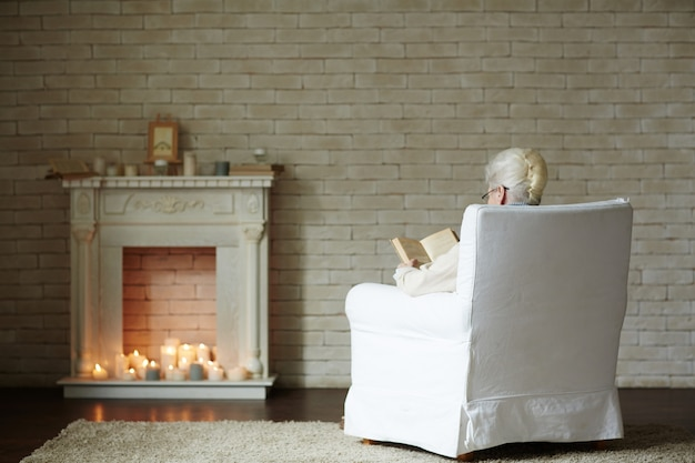 Winter evening by fireplace Free Photo