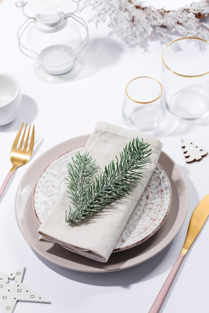 Winter festive table setting with cutlery on table. christmas tableware. Premium Photo