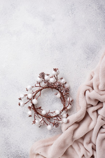 Winter flat lay with christmas wreath Premium Photo