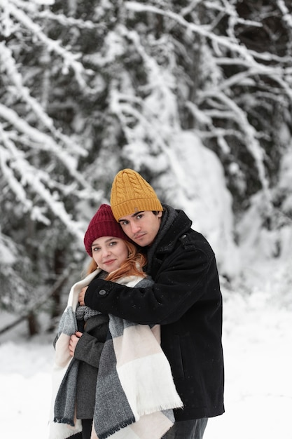 Winter frozen landscape with couple hugging Free Photo