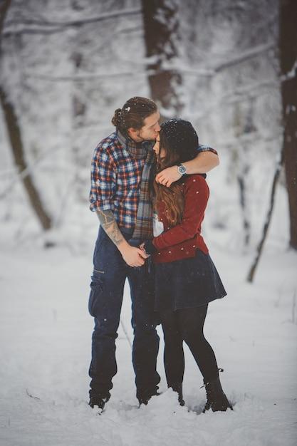 Winter fun couple playful Premium Photo