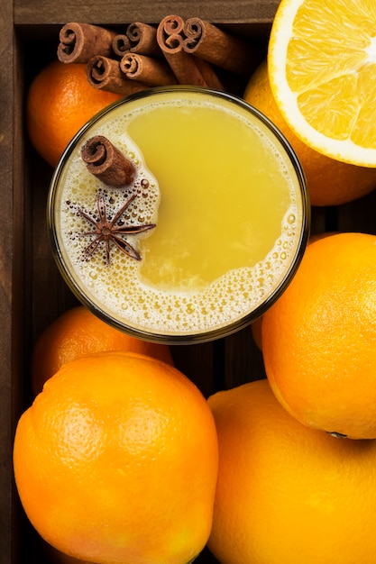 Winter hot drink from oranges and spices on a black surface Premium Photo