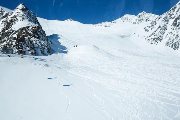 Winter landscape, panorama of the ski resort with ski slopes. alps. austria. pitztaler gletscher. wildspitzbahn Premium Photo
