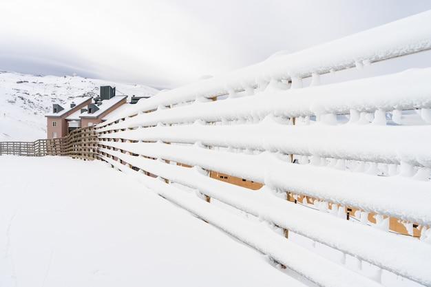 Winter mountains landscape with snowed fence in sierra nevada Premium Photo