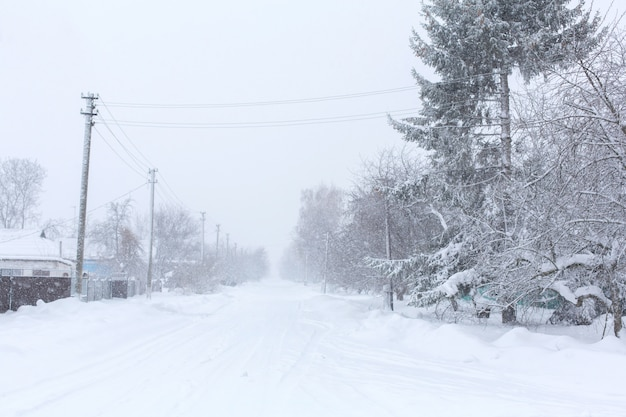 Winter, rural streets are covered with snow. snow blizzard Premium Photo