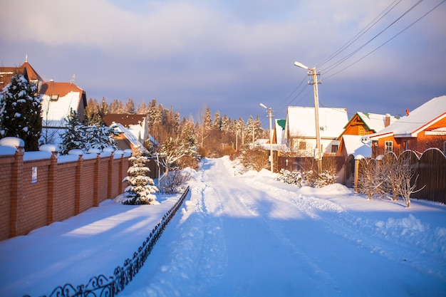 Winter snowy landscape with houses in a small village Premium Photo