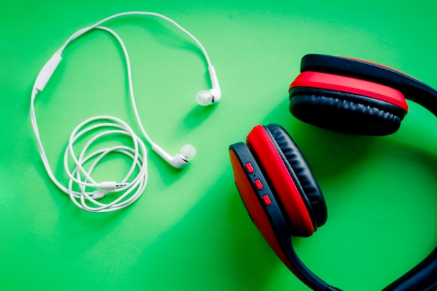 Wireless over-ear full size headphones. black and red leather isolated with clipping path. wireless and corded headphones, earphones. music accessories. Premium Photo