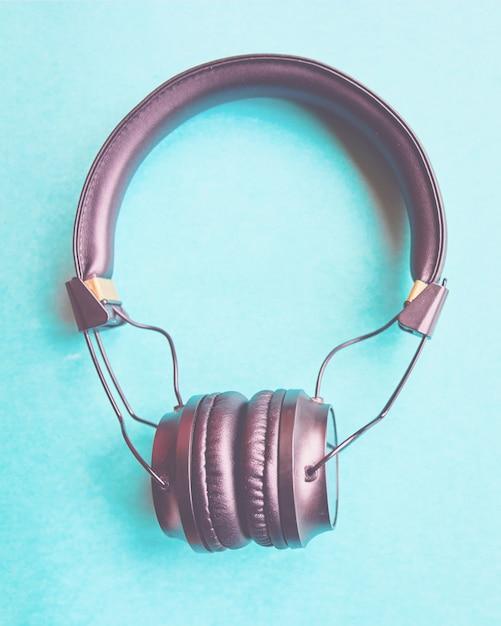 Wireless headphones on colorful blue background. Premium Photo