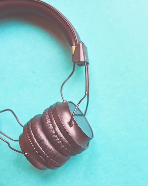 Wireless headphones on colorful blue background. Premium Photo