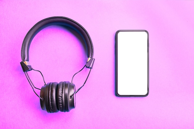 Wireless headphones and frameless smartphone on colorful background Premium Photo