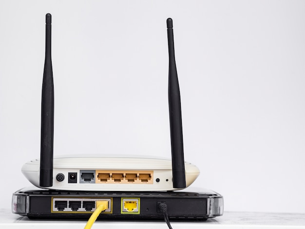 Wireless routers stacked on one another Free Photo