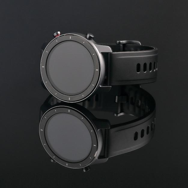 縁にリスクのある丸いマットブラックケースのワイヤレススマートウォッチ。反射のある黒いガラスのシリコンストラップ。 Premium写真