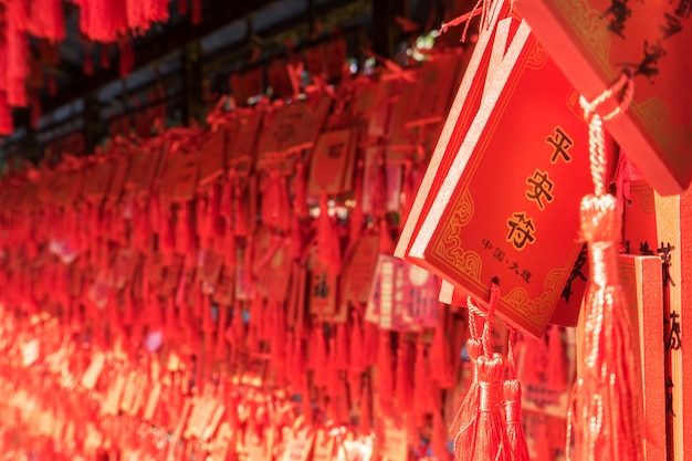 The wish tag is usually placed by chinese and tourists at any temple, to pray to god. Premium Photo