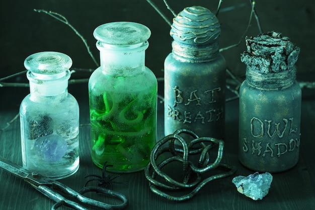 Witch apothecary jars magic potions halloween decoration Premium Photo