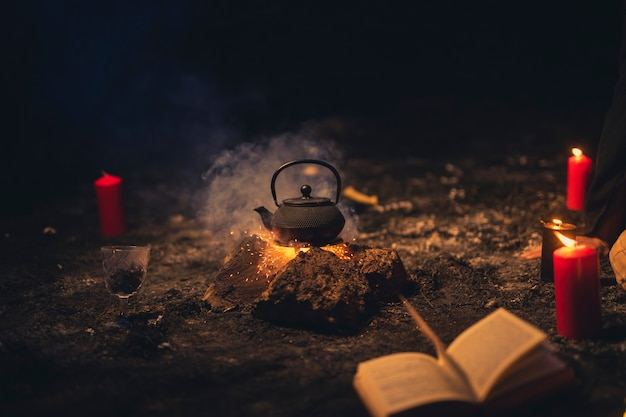 Witchcraft arrangement with teapot in the middle Free Photo