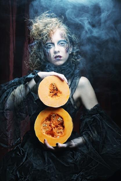 With with pumkin. halloween theme. Premium Photo