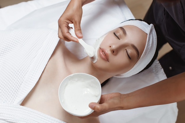 Woman applying cosmetic alginate mask Premium Photo