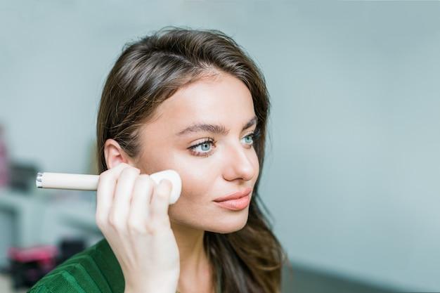 Woman applying cosmetic Premium Photo