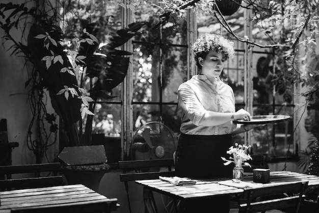 Woman arranging flowers in a greenhouse Free Photo