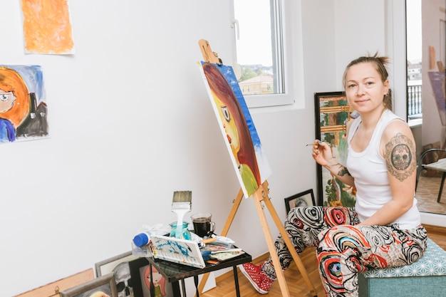 Woman artist working in studio Free Photo