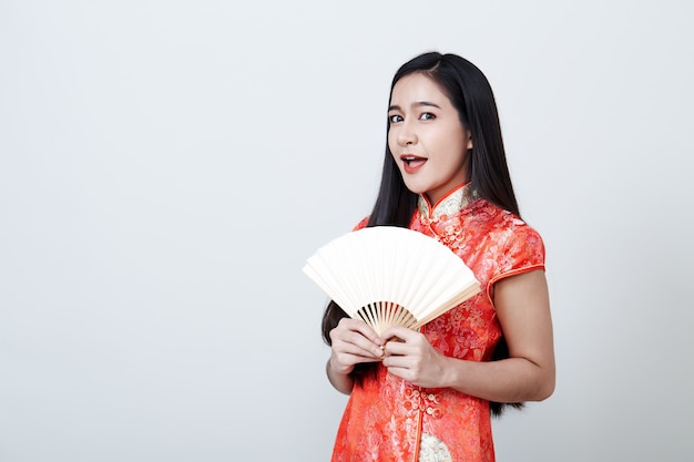 Woman asian wearing red dress in chinese new year Premium Photo