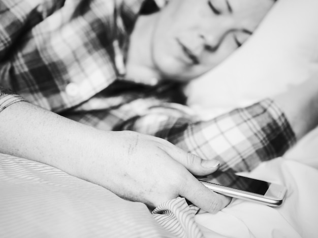 Woman asleep with mobile in hand Free Photo