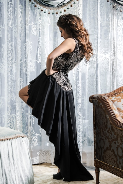 Woman in beautiful black dress Premium Photo