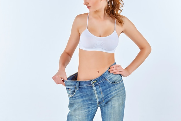 Woman became skinny and wearing old jeans Free Photo