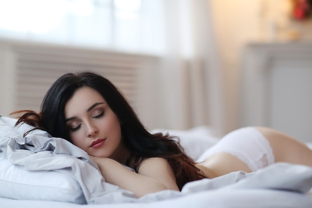 Woman in bed Free Photo