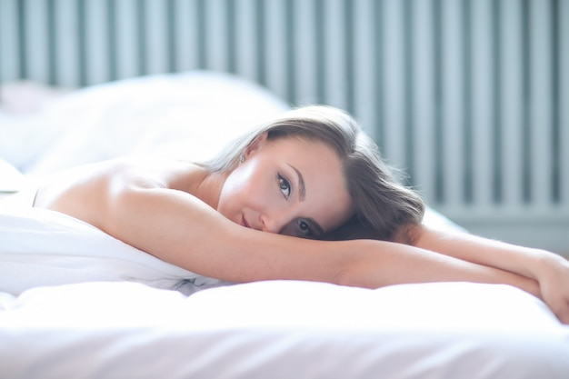 Woman in the bed Free Photo