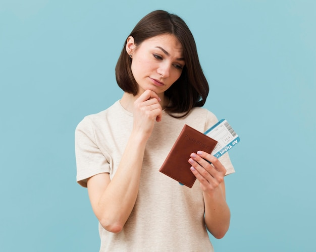 Woman being concerned about not using her airplane tickets Free Photo
