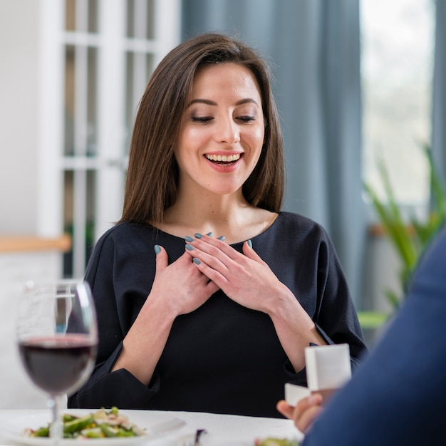 Woman being happy about being asked to marry her boyfriend Free Photo